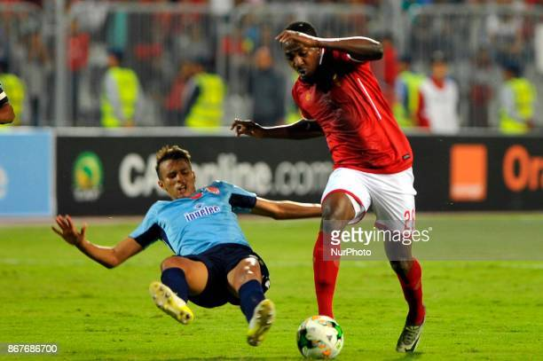 Wydad's Defnder Badr Gaddarine vies for the ball with Ahly's forward Junior Ajayi during the CAF Champions League final football match between AlAhly...