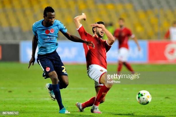 Wydad's Defnder Mouhamed Ouattara vies for the ball with Ahly's forward Oualid Azaro during the CAF Champions League final football match between...