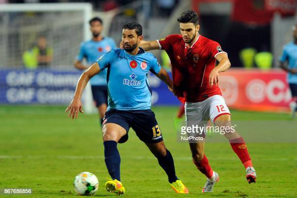 Wydad's Defnder Rabeh Youssef vies for the ball with Ahly's forward Oualid Azaro during the CAF Champions League final football match between AlAhly...