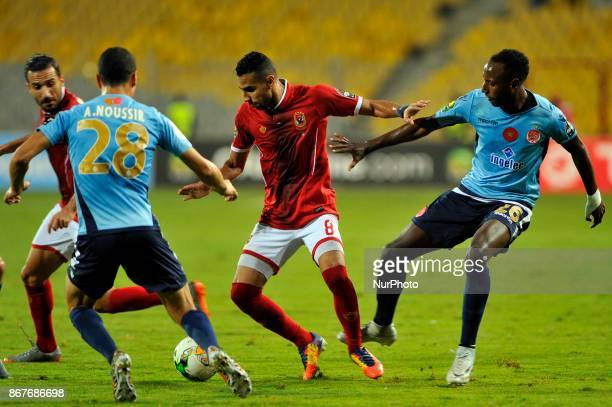Wydad's midfielder Abdeladim Khadrouf vies for the ball with Ahly's midfielder Moamen Zakaria during the CAF Champions League final football match...