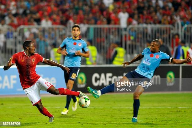 Wydad's midfielder Brahim Nakach vies for the ball with Ahly's forward Junior Ajayi during the CAF Champions League final football match between...