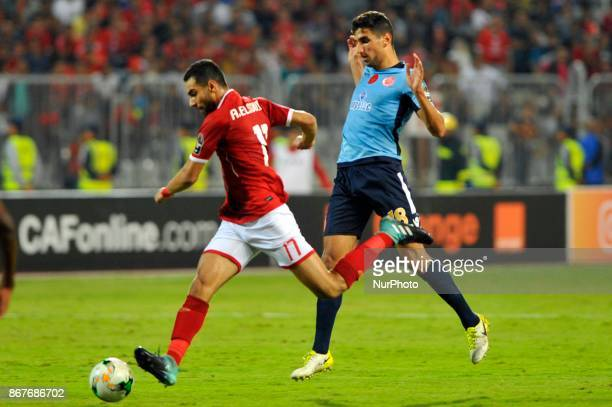 Wydad's midfielder Walid El Karti vies for the ball with Ahly's midfielder Amro Elsoulia during the CAF Champions League final football match between...