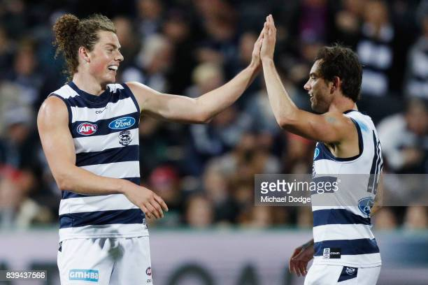 Wylie Buzza of the Cats celebrates a goal with Daniel Menzel during the round 23 AFL match between the Geelong Cats and the Greater Western Sydney...