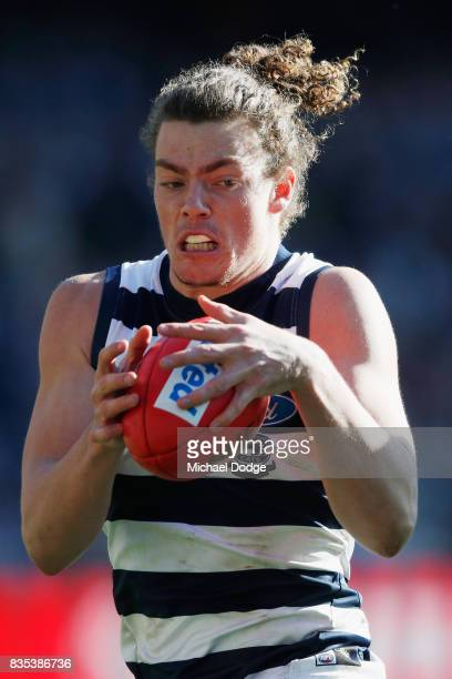 Wylie Buzza of the Cats gathers the ball during the round 22 AFL match between the Collingwood Magpies and the Geelong Cats at Melbourne Cricket...