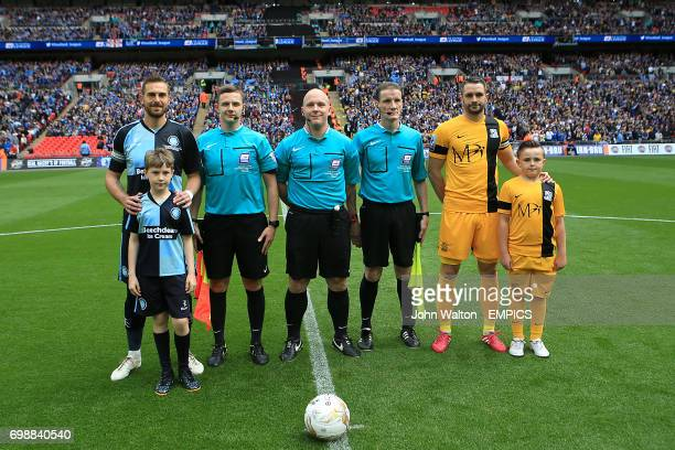 Wymcobe Wanderers' Paul Hayes Southend United's John White match referee Simon Hooper and mascots