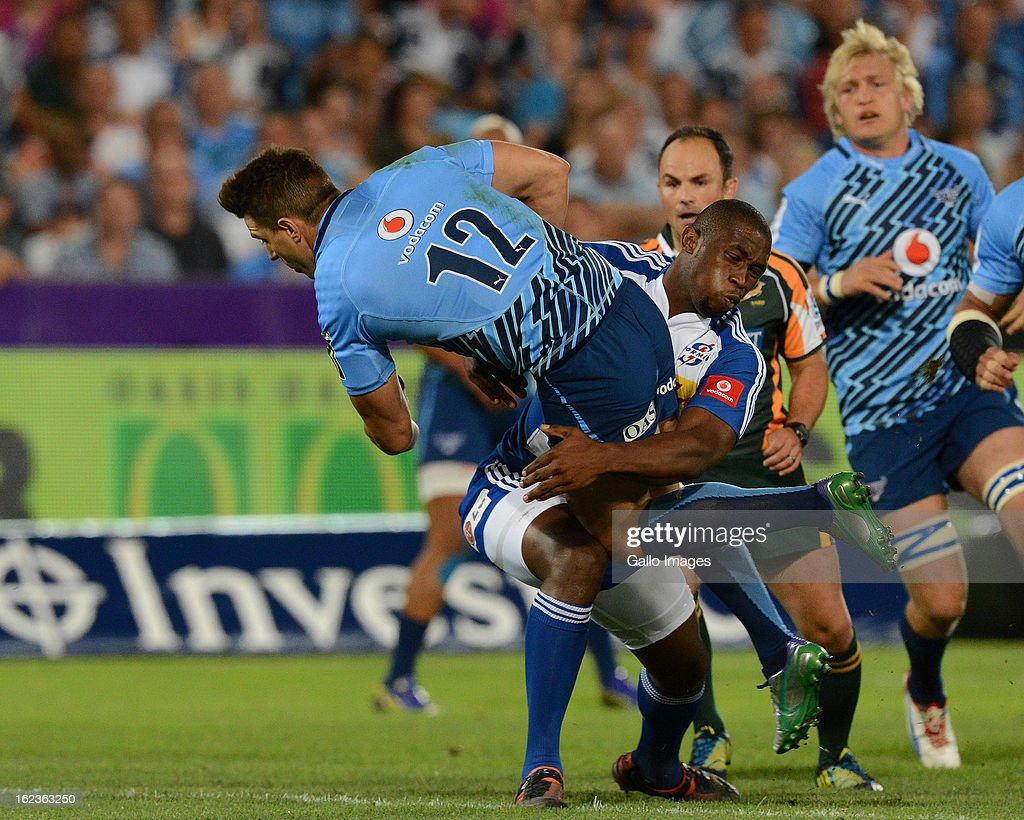 <a gi-track='captionPersonalityLinkClicked' href=/galleries/search?phrase=Wynand+Olivier&family=editorial&specificpeople=540920 ng-click='$event.stopPropagation()'>Wynand Olivier</a> of the Bulls gets tackled by Siya Kolisi of the Stormers during the Super Rugby match between Vodacom Bulls and DHL Stormers from Loftus Versfeld Stadium on February 22, 2013 in Pretoria, South Africa.