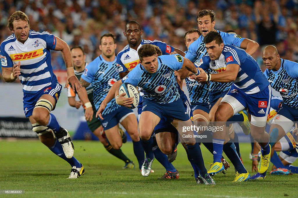 <a gi-track='captionPersonalityLinkClicked' href=/galleries/search?phrase=Wynand+Olivier&family=editorial&specificpeople=540920 ng-click='$event.stopPropagation()'>Wynand Olivier</a> of the Bulls gets tackled during the Super Rugby match between Vodacom Bulls and DHL Stormers from Loftus Versfeld Stadium on February 22, 2013 in Pretoria, South Africa.