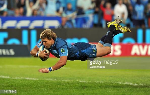 Wynand Olivier of the Bulls scores a try during the Super Rugby Rd 13 match between Vodacom Bulls and Melbourne Rebels at Loftus Versfeld on May 14...