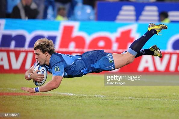 Wynand Olivier of the Bulls scores during the Super Rugby match between Vodacom Bulls and Waratahs at Loftus Versfeld on June 03 2011 in Pretoria...