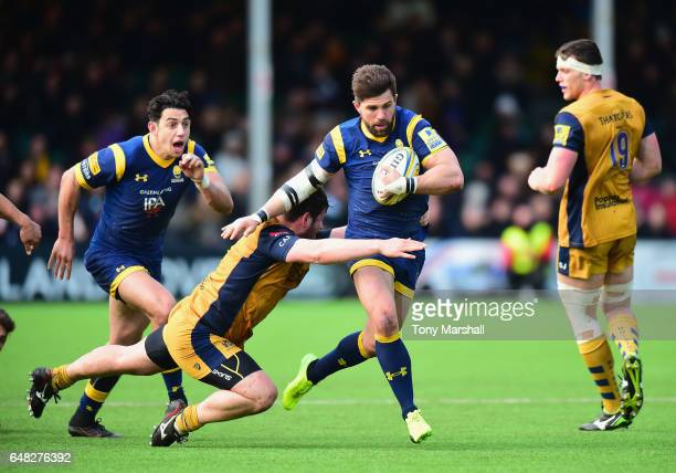 Wynand Olivier of Worcester Warriors is tackled by Marc Jones of Bristol Rugby during the Aviva Premiership match between Worcester Warriors and...