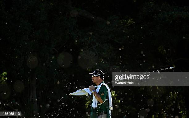Wynand Stander caddie to Louis Oosthuizen of South Africa looks on as he is surrounded by flying ants during the second round of the Africa Open at...