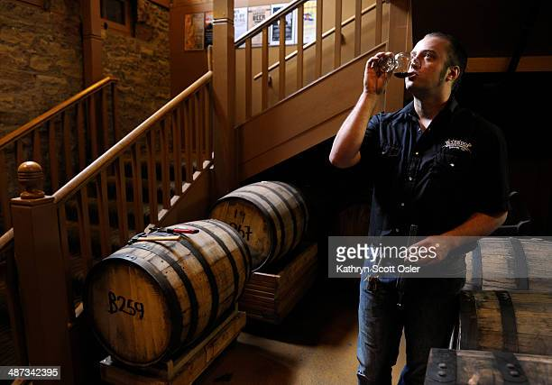 Wynkoop Brewing CO's head brewer Andy Brown takes a small taste of the Chancellor beer which has been inside a whiskey barrel for 16 months This beer...