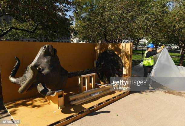 Wynn Buzzell works with a crew on the installation of Ai Weiweis internationally renowned Circle of Animals/Zodiac Heads at Civic Center Park on...