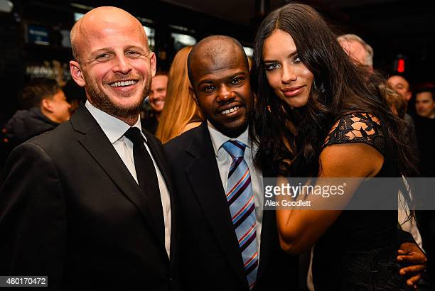 Wynn Walent poses for a picture with Dr Marc Edson Augustin and Adriana Lima during an event for the St Luke Foundation For Haiti at Acme on December...