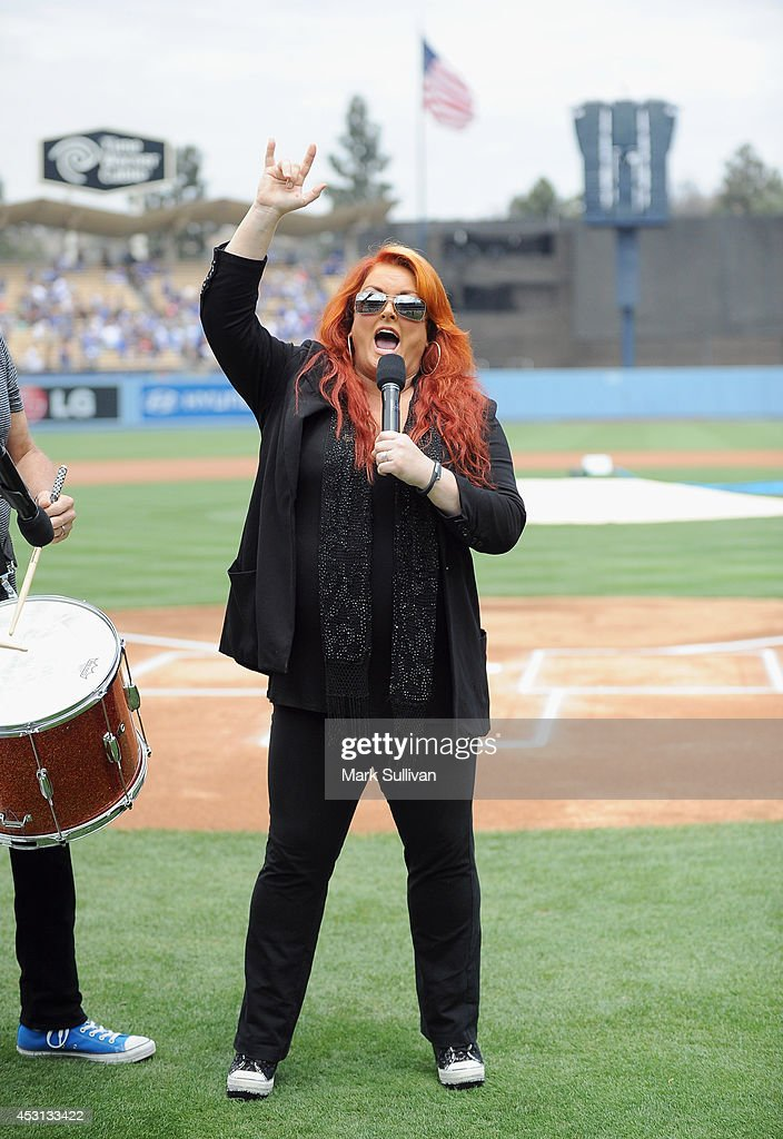 Wynonna Judd sings the national anthem before the game between the Chicago Cubs and Los Angeles Dodgers at Dodger Stadium on August 3 2014 in Los...