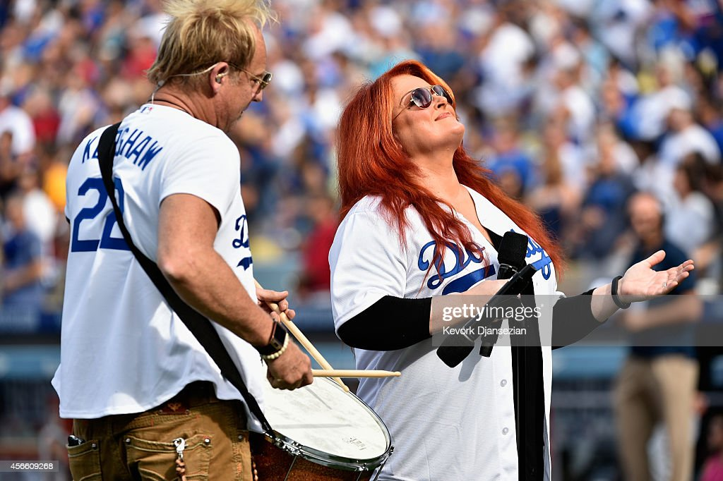 Wynonna Judd sings the national anthem prior to the start of Game One of the National League Division Series between the St Louis Cardinals and te...