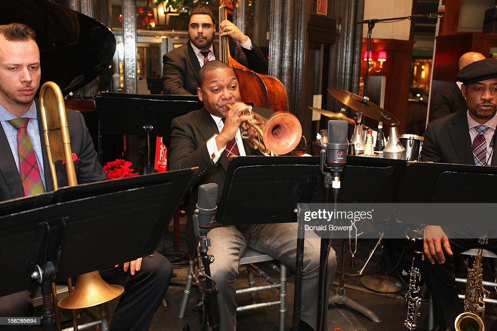<a gi-track='captionPersonalityLinkClicked' href=/galleries/search?phrase=Wynton+Marsalis&family=editorial&specificpeople=215421 ng-click='$event.stopPropagation()'>Wynton Marsalis</a> and the members of the Jazz at Lincoln Center Orchestra perform during The Brooks Broandthers Hosts Seventh Annual Holiday Celebration To Benefit St Jude Children's Research Hospital on December 12, 2012 in New York City.