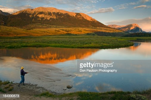USA, Wyoming, Bridger-Teton National Forest, Green River, Person fly-fishing