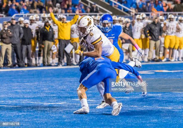 Wyoming Cowboys defensive back Marcus Epps gets stopped on the 3yard line by Boise State Broncos cornerback DeAndre Pierce in a touchdown attempt...