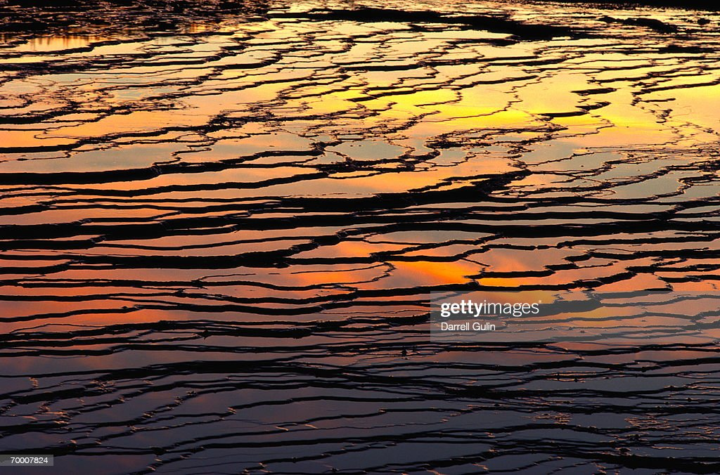 USA, Wyoming, sun reflecting on Midway Geyser Basin, sunset : Stock Photo