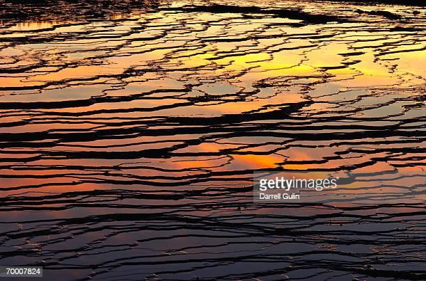 USA, Wyoming, sun reflecting on Midway Geyser Basin, sunset