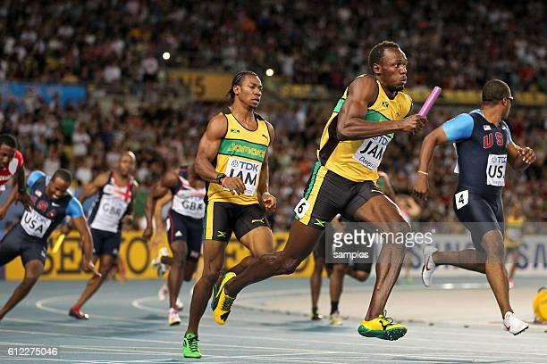 4 x 100 Meter Staffel Jamaika mit neuem Weltrekord Wechsel auf Yohan Blake Usain Bolt während Darvis Patton sturzt und Walter Dix ins Leere läuft...