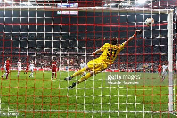 Xab Alonso of Muenchen scores the opening goal against Christian Mathenia keeper of Darmstadt during the round of 16 DFB Cup match between FC Bayern...