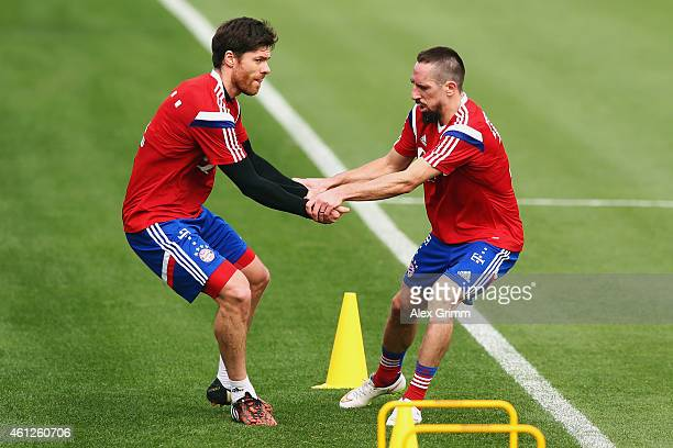 Xabi Alonso and Franck Ribery exercise during day 2 of the Bayern Muenchen training camp at ASPIRE Academy for Sports Excellence on January 10 2015...
