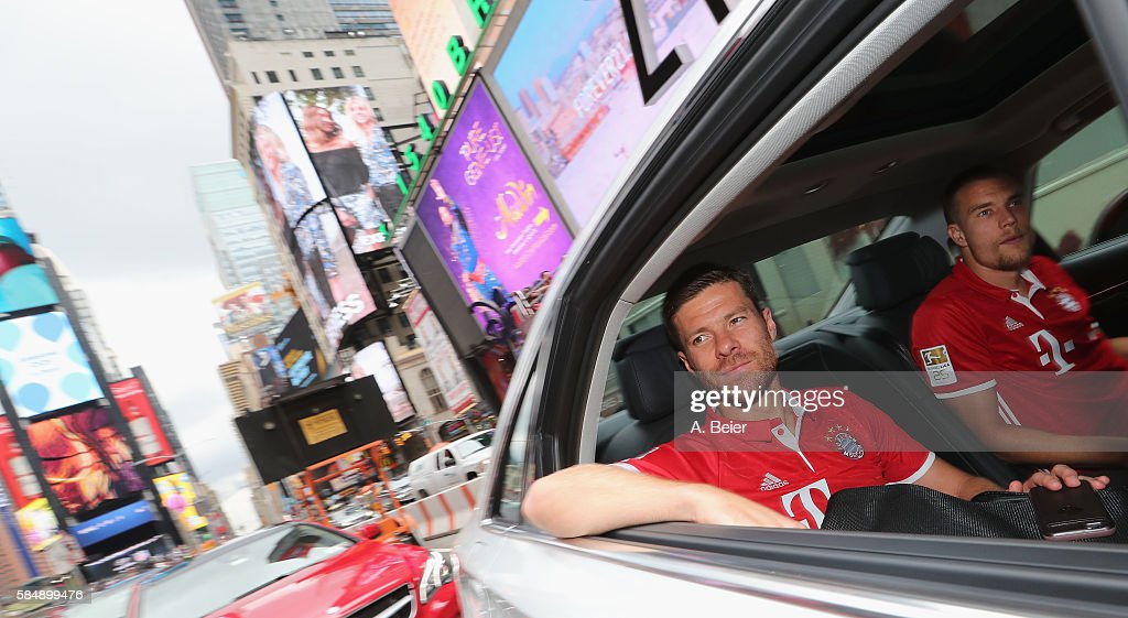 Xabi Alonso and Holger Badstuber of FC Bayern Muenchen are pictured in a limousine at Times Square during the AUDI Summer Tour USA 2016 on July 31...