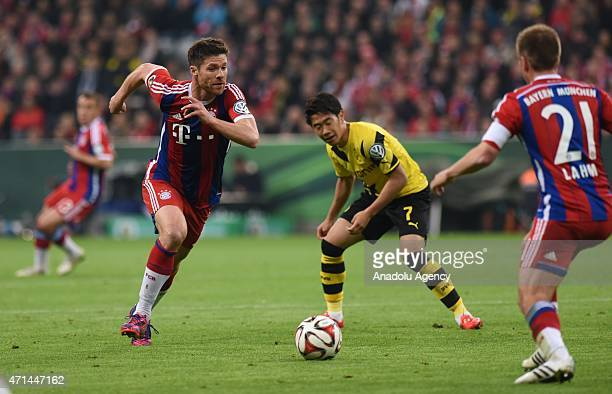 Xabi Alonso and Philipp Lahm of Bayern Munich vie for ball with Shinji Kagawa of Borussia Dortmund during the semifinal German Cup soccer match...
