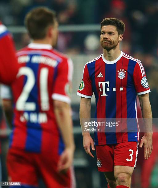 Xabi Alonso and Philipp Lahm of Muenchen react after the DFB Cup Semi Final match between FC Bayern Muenchen and Borussia Dortmund at Allianz Arena...
