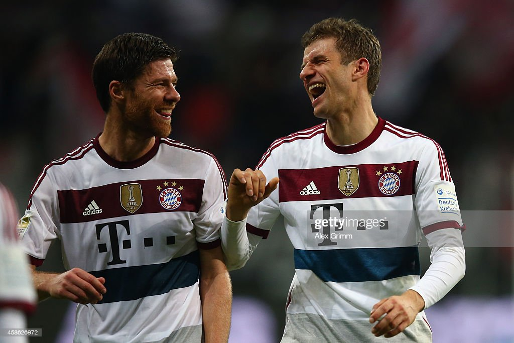 Xabi Alonso (L) and Thomas Mueller of Muenchen laugh after the Bundesliga match between Eintracht Frankfurt and FC Bayern Muenchen at Commerzbank-Arena on November 8, 2014 in Frankfurt am Main, Germany.