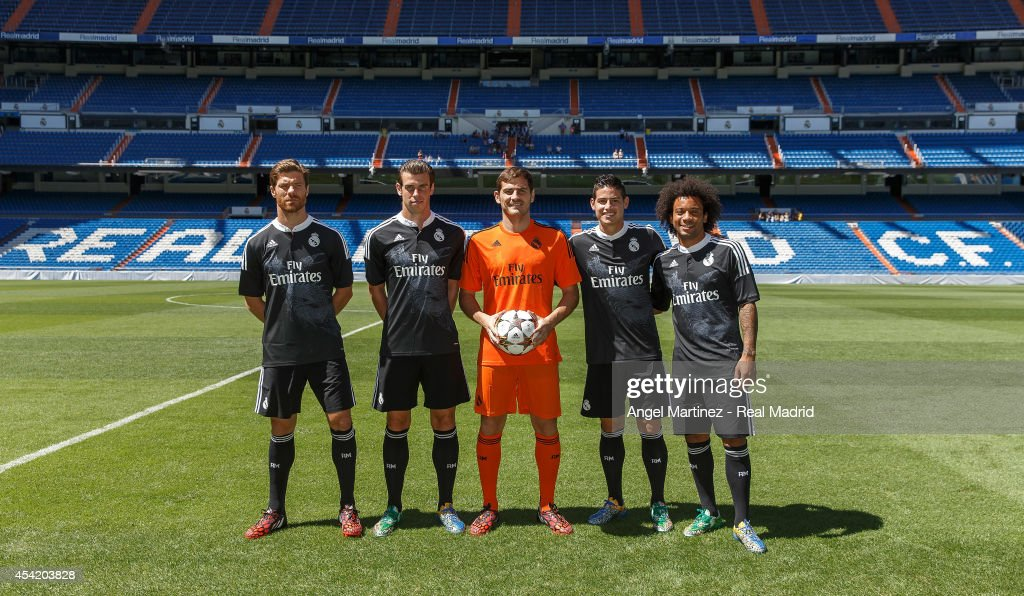 Xabi Alonso, Gareth Bale, Iker Casillas, James Rodriguez and Marcelo Vieira of Real Madrid during the Adidas 3rd kit launch at Estadio Santiago Bernabeu on August 26, 2014 in Madrid, Spain.