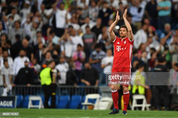 Xabi Alonso of Bayern Muenchen applauds the fans after the UEFA Champions League Quarter Final second leg match between Real Madrid CF and FC Bayern...