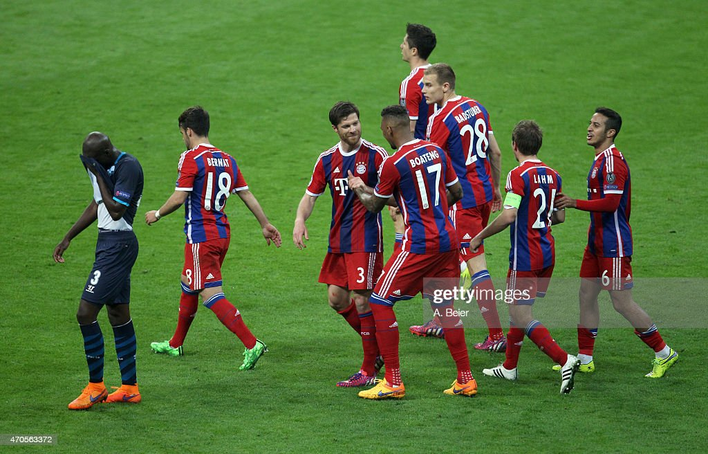 <a gi-track='captionPersonalityLinkClicked' href=/galleries/search?phrase=Xabi+Alonso&family=editorial&specificpeople=213833 ng-click='$event.stopPropagation()'>Xabi Alonso</a> (3rdL) of Bayern Muenchen celebrates his goal with teammate <a gi-track='captionPersonalityLinkClicked' href=/galleries/search?phrase=Jerome+Boateng&family=editorial&specificpeople=2192287 ng-click='$event.stopPropagation()'>Jerome Boateng</a> (4thL) as <a gi-track='captionPersonalityLinkClicked' href=/galleries/search?phrase=Bruno+Martins+Indi&family=editorial&specificpeople=7155940 ng-click='$event.stopPropagation()'>Bruno Martins Indi</a> (L) of FC Porto reacts during the Champions League quarter final second leg match between FC Bayern Muenchen and FC Porto at Allianz Arena on April 21, 2015 in Munich, Germany.