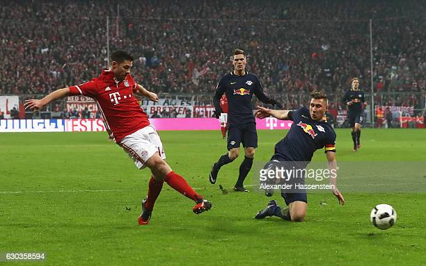 Xabi Alonso of Bayern Muenchen scores his sides second goal during the Bundesliga match between Bayern Muenchen and RB Leipzig at Allianz Arena on...