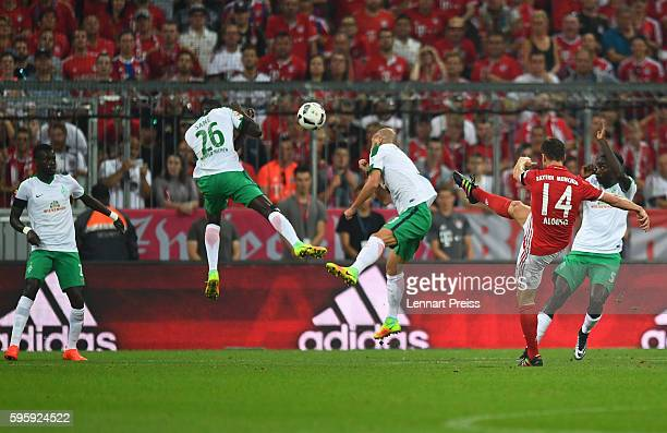 Xabi Alonso of Bayern Muenchen scores the opening goal during the Bundesliga match between Bayern Muenchen and Werder Bremen at Allianz Arena on...