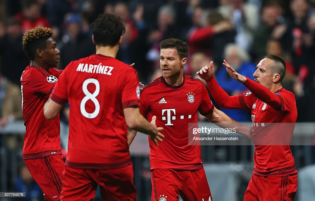 Xabi Alonso of Bayern Munich (2R) celebrates with David Alaba (L), Javi Martinez (8) and Franck Ribery of Bayern Munich (R) during UEFA Champions League semi final second leg match between FC Bayern Muenchen and Club Atletico de Madrid at Allianz Arena on May 3, 2016 in Munich, Germany.
