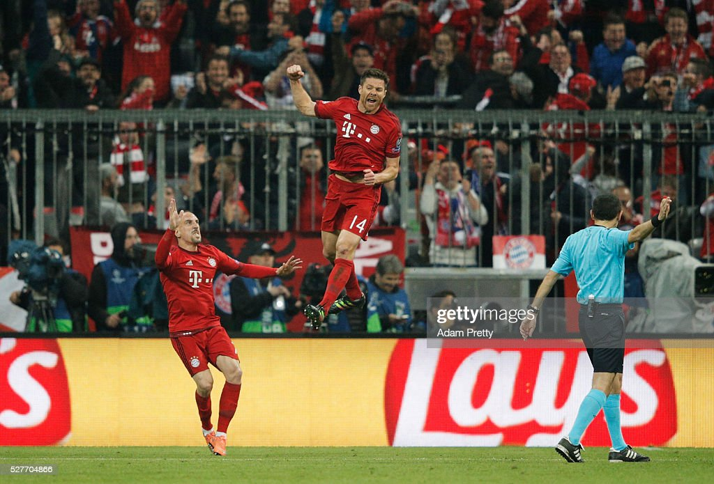 <a gi-track='captionPersonalityLinkClicked' href=/galleries/search?phrase=Xabi+Alonso&family=editorial&specificpeople=213833 ng-click='$event.stopPropagation()'>Xabi Alonso</a> of Bayern Munich (14) celebrates with <a gi-track='captionPersonalityLinkClicked' href=/galleries/search?phrase=Franck+Ribery&family=editorial&specificpeople=490869 ng-click='$event.stopPropagation()'>Franck Ribery</a> as he scores their first goal from a free kick during UEFA Champions League semi final second leg match between FC Bayern Muenchen and Club Atletico de Madrid at Allianz Arena on May 3, 2016 in Munich, Germany.