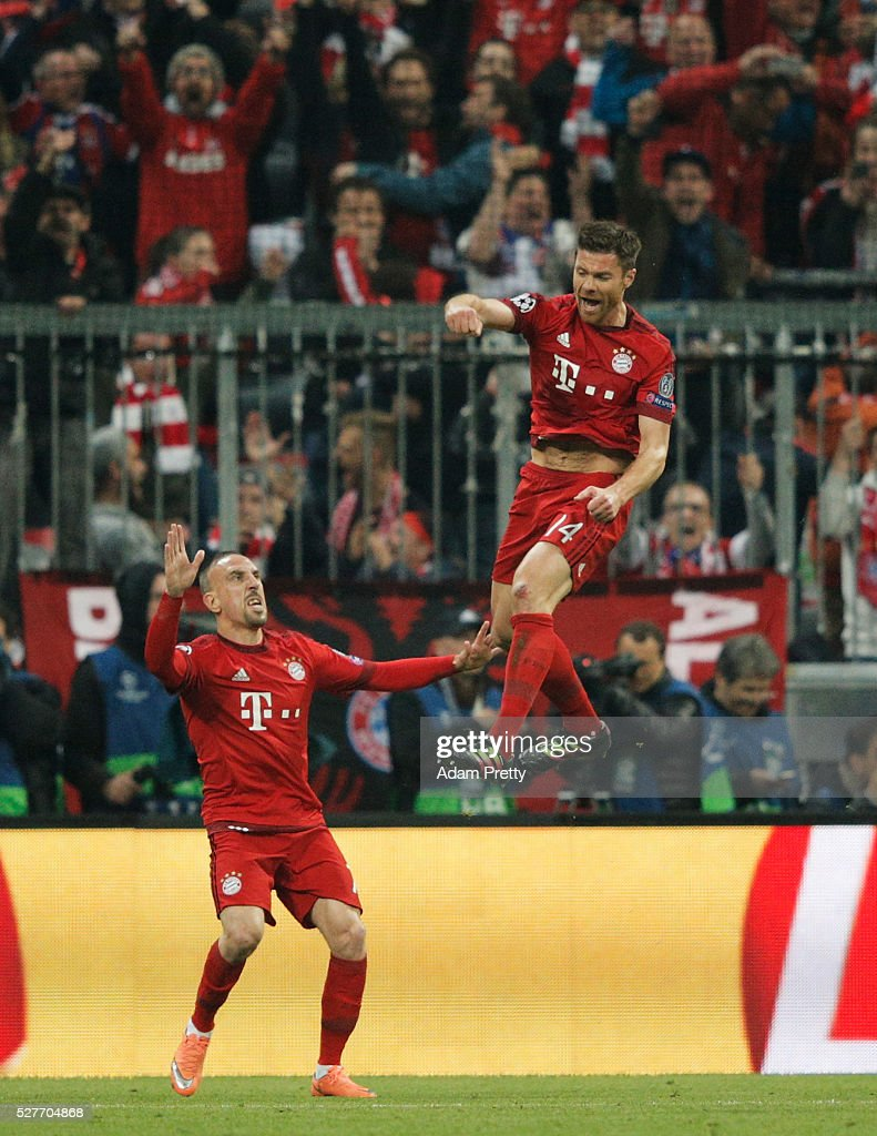 Xabi Alonso of Bayern Munich (14) celebrates with Franck Ribery as he scores their first goal from a free kick during UEFA Champions League semi final second leg match between FC Bayern Muenchen and Club Atletico de Madrid at Allianz Arena on May 3, 2016 in Munich, Germany.