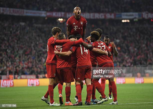 Xabi Alonso of Bayern Munich celebrates with team mates as he scores their first goal from a free kick during UEFA Champions League semi final second...