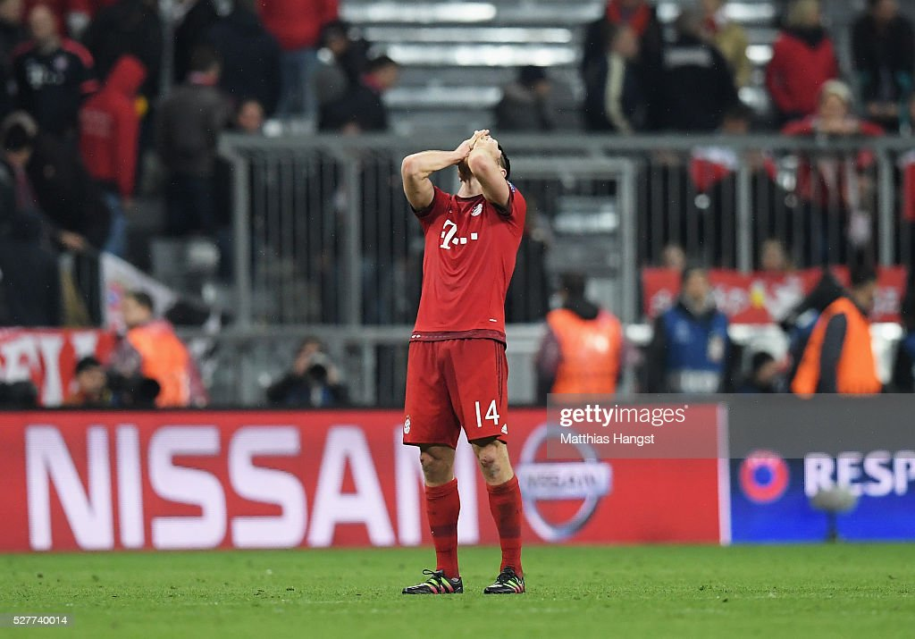 Xabi Alonso of Bayern Munich looks dejected after the UEFA Champions League semi final second leg match between FC Bayern Muenchen and Club Atletico de Madrid at Allianz Arena on May 3, 2016 in Munich, Germany. Bayern Munich won the match 2-1, but Atletico Madrid reached the final on the away goals rule.