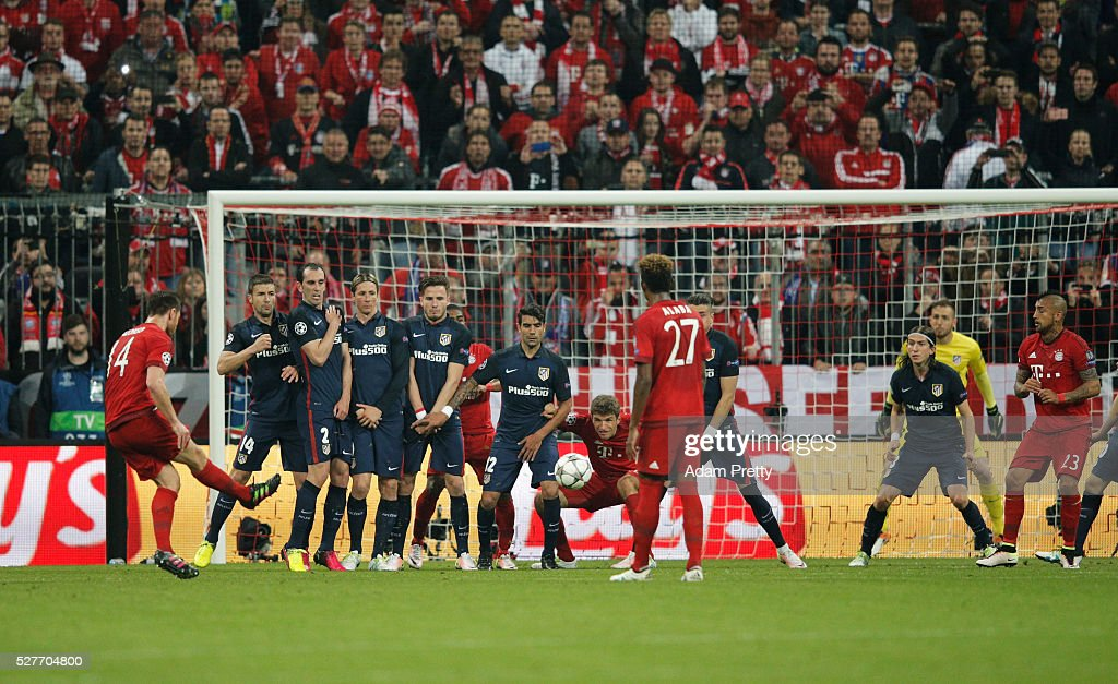 Xabi Alonso of Bayern Munich (14) scores their first goal from a free kick during UEFA Champions League semi final second leg match between FC Bayern Muenchen and Club Atletico de Madrid at Allianz Arena on May 3, 2016 in Munich, Germany.