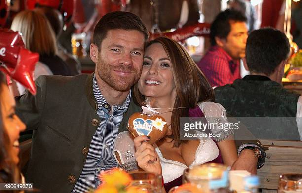 Xabi Alonso of FC Bayern Muenchen and his wife Nagore Aramburo attend the Oktoberfest beer festival 2015 at Theresienwiese on September 30 2015 in...