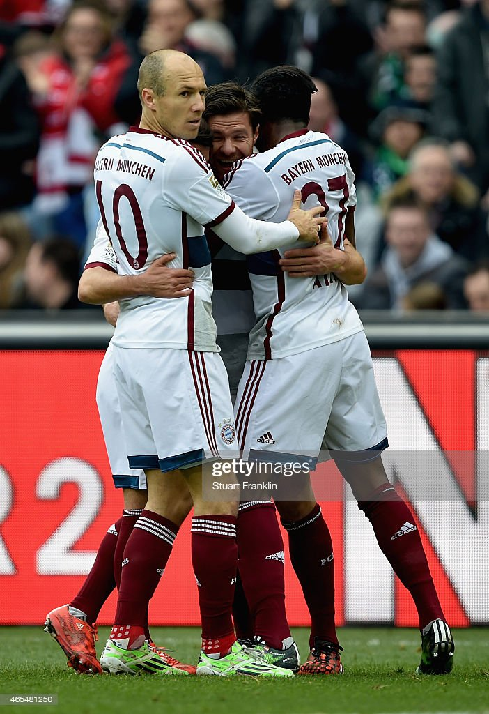 <a gi-track='captionPersonalityLinkClicked' href=/galleries/search?phrase=Xabi+Alonso&family=editorial&specificpeople=213833 ng-click='$event.stopPropagation()'>Xabi Alonso</a> of FC Bayern Muenchen celebrates with team mates <a gi-track='captionPersonalityLinkClicked' href=/galleries/search?phrase=Juan+Bernat&family=editorial&specificpeople=8821838 ng-click='$event.stopPropagation()'>Juan Bernat</a> and <a gi-track='captionPersonalityLinkClicked' href=/galleries/search?phrase=Arjen+Robben&family=editorial&specificpeople=194740 ng-click='$event.stopPropagation()'>Arjen Robben</a> as he scores their first goal during the Bundesliga match between Hannover 96 and FC Bayern Muenchen at HDI-Arena on March 7, 2015 in Hanover, Germany.