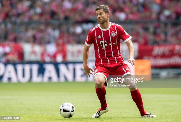Xabi Alonso of FC Bayern Muenchen runs with the ball during the Bundesliga match between Bayern Muenchen and SC Freiburg at Allianz Arena on May 20...