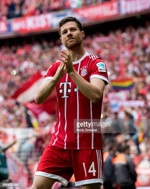 Xabi Alonso of FC Bayern Muenchen waves to his fans during his farewell ceremony after the Bundesliga match between Bayern Muenchen and SC Freiburg...