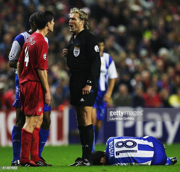 Xabi Alonso of Liverpool argues his point with Referee Anders Frisk during the UEFA Champions League Group A match between Liverpool and Deportivo La...