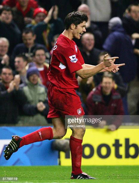Xabi Alonso of Liverpool celebrates his goal during the Barclays Premiership match between Liverpool and Arsenal at Anfield on November 28 2004 in...