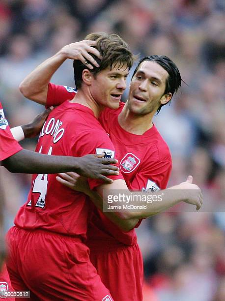 Xabi Alonso of Liverpool celebrates his goal with Luis Garcia during the Barclays Premiership match between Liverpool and West Ham United at Anfield...